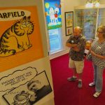 one of the rooms dedicated to Jim Davis — with Gregory Smith and Sharon Smith.
